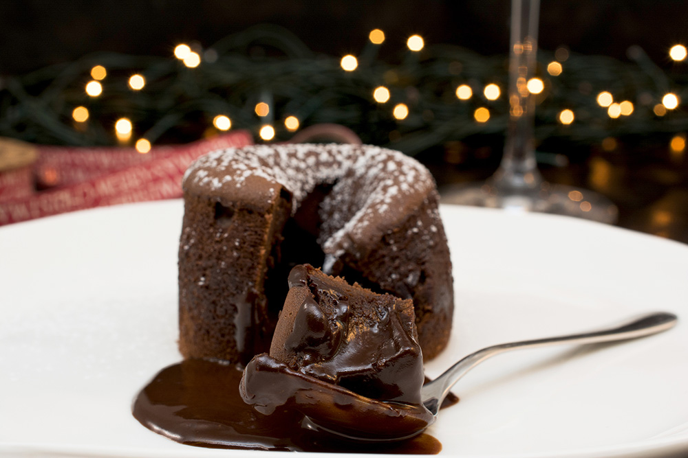 Chocolate molten cake with lights in the background